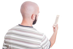 Man looking at thermometer Royalty Free Stock Images