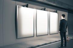 Man looking on three blank billboard Stock Photography