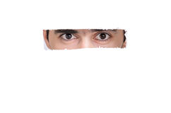 Man looking throught a hole at you Royalty Free Stock Photo