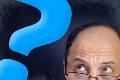 Man looking to big question mark Royalty Free Stock Photography