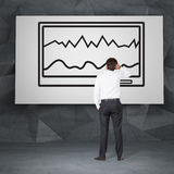 Man looking to chart. Businessman looking to chart on drawing touch pad Stock Images