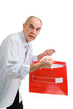 Man looking to color paper bags Royalty Free Stock Photography