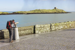 Man looking to Dalkey island by binoculars Royalty Free Stock Image