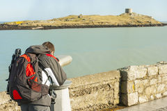 Man looking to Dalkey island by binoculars Stock Image