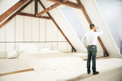 Man looking in to the distance. Young man looking into the distnace in loft bedroom interior. Research concept. 3D Rendering Royalty Free Stock Image