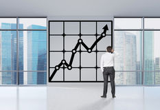 Man looking to drawing chart Royalty Free Stock Photo
