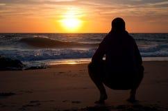 Man looking to the horizon at the beach, at sunset. Vieux Boucau, France Royalty Free Stock Image