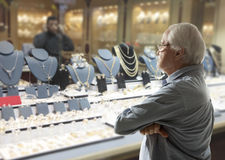 Man looking to jewellery Stock Images