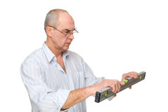 Man looking to  level tool Stock Photography