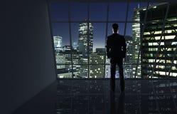 Man looking to night city Stock Photo