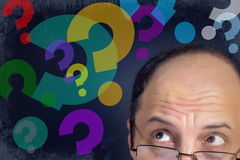 Man looking to question marks Royalty Free Stock Photography