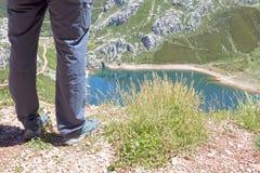 Man looking to Saliencia& x27;s lake full of water in Asturias Royalty Free Stock Photo
