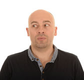 Man looking to the side. Half body portrait of bald middle aged man with eyes looking to the side, white background Stock Photography