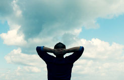 Man looking to the sky Stock Photography