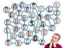 Man looking to social network group. Pensive men looking up to social network group royalty free stock photo