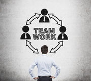 Man looking to teamwork Stock Photo
