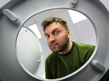 Man looking in the toilet bowl Royalty Free Stock Photography
