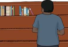 Man Looking at Top of Shelf Royalty Free Stock Image