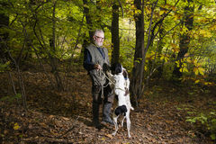 Man looking for truffles in the woods with his dog Royalty Free Stock Photos