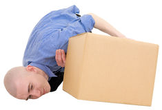 Man looking under cardboard box Royalty Free Stock Photos