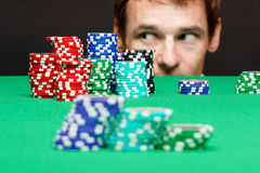 Man looking under the table on playing chips Royalty Free Stock Images