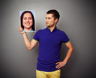 Man looking with understand at smiley woman Stock Images