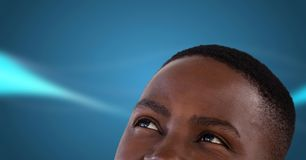 Man looking up with blue background. Digital composite of Man looking up with blue background Stock Photo