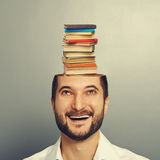 Man looking up at books in the head Stock Photography
