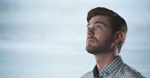 Man looking up with bright background. Digital composite of Man looking up with bright background Stock Images