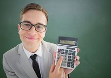 Man looking up with calculator against green chalkboard. Digital composite of Man looking up with calculator against green chalkboard Stock Photography