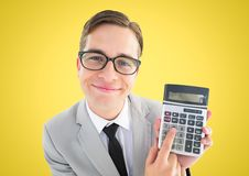Man looking up with calculator against yellow background. Digital composite of Man looking up with calculator against yellow background Royalty Free Stock Image