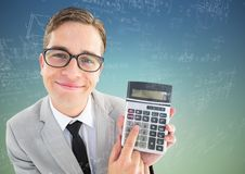 Man looking up with calculator and math doodles against blue green background. Digital composite of Man looking up with calculator and math doodles against blue Stock Image