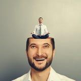 Man looking up at calm yoga man Stock Photo