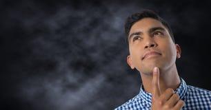 Man looking up with dark background. Digital composite of Man looking up with dark background Stock Photos