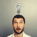 Man looking up at drawing light bulb Stock Photography