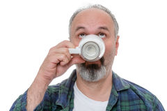 Man looking up while drinking morning coffee Royalty Free Stock Images