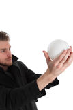 Man looking up into a glass ball Stock Photo