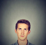 Man looking up gray background with copy space above head. Man looking up at blank copy space above head Stock Photography