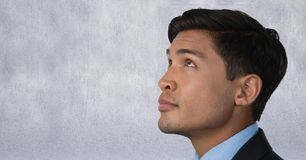 Man looking up with grey background. Digital composite of Man looking up with grey background Royalty Free Stock Photography