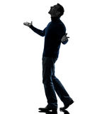Man looking up happy silhouette full length Stock Image