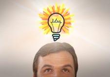 Man looking up at light bulb idea. Digital composite of man looking up at light bulb idea Stock Image