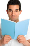 Man looking up from an open book Stock Photos