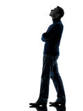 Man looking up pensive silhouette full length Royalty Free Stock Image