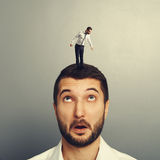 Man looking up at small young man. Amazed man looking up at small young man on the head Stock Photos