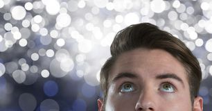 Man looking up with sparkling background. Digital composite of Man looking up with sparkling background Stock Image