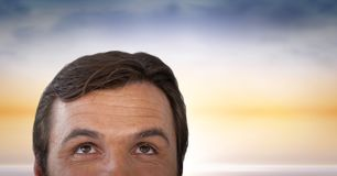 Man looking up with sunset background. Digital composite of Man looking up with sunset background Royalty Free Stock Photo