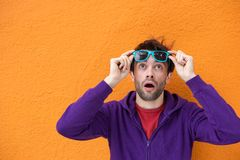 Man looking up with surprised expression Royalty Free Stock Images