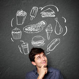 Man looking up thinking what to eat Royalty Free Stock Image