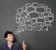 Man looking up to bubble speech Stock Images