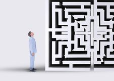 Man looking up to a maze Stock Photo
